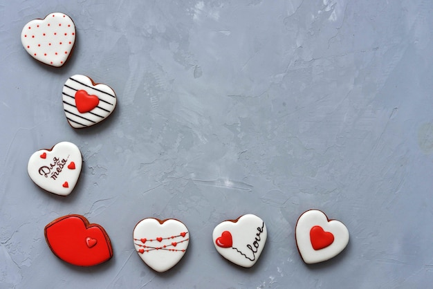 Valentine's day homemade cookies on ultimate gray background, top view. space for text. delicious and sweet, covered with icing with a beautiful pattern gingerbread inscription in russian - for you Premium Photo