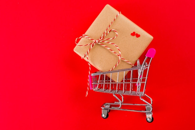 Valentine's day present in toy shopping trolley Free Photo