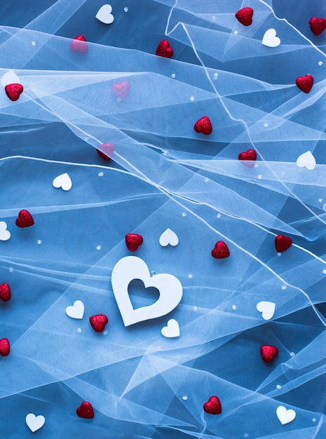 Valentine's day surface, with hearts and various romentic elements Premium Photo