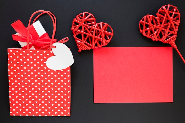 Valentines day bag with gift and paper Free Photo