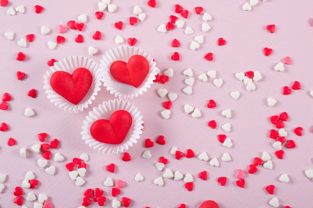 Valentines day candy heart background of red, white and pink sprinkles Premium Photo