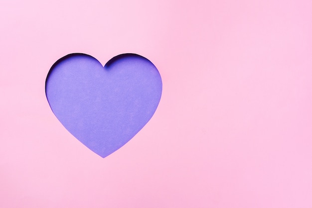 Valentines day card. cutted heart in punchy pastel paper background. Premium Photo