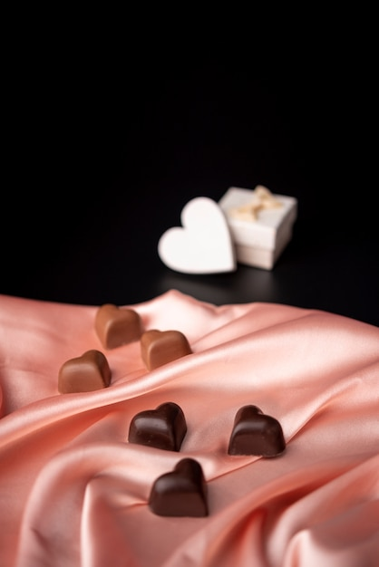 Free Photo Valentines Day Chocolates On Satin With Copy Space