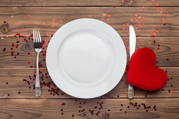 Valentines day composition on wooden table Premium Photo