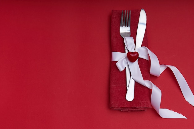 Valentines day concept. silver cutlery with heart Premium Photo