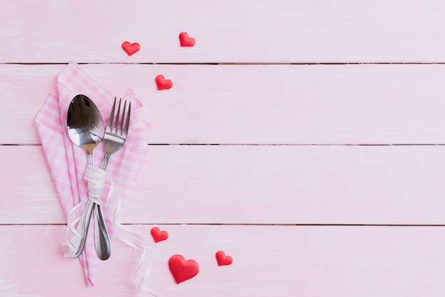 Valentines day and love concept on pink wooden background. Premium Photo