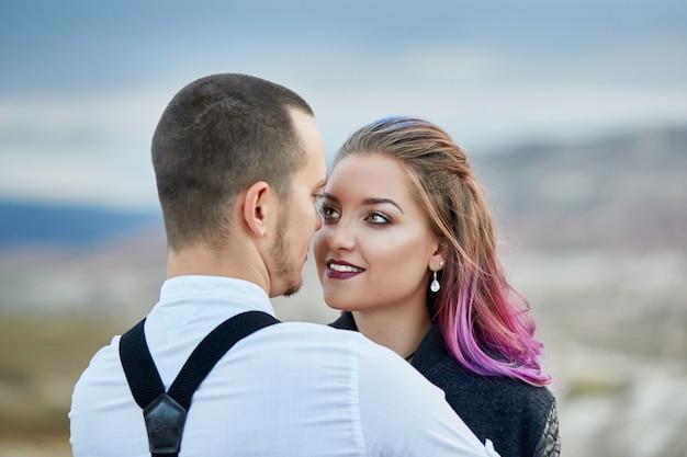 Valentines day loving couple in nature hugs Premium Photo