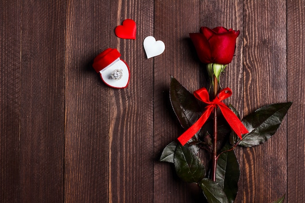 Valentines day marry me wedding engagement ring in box with red rose gift Free Photo