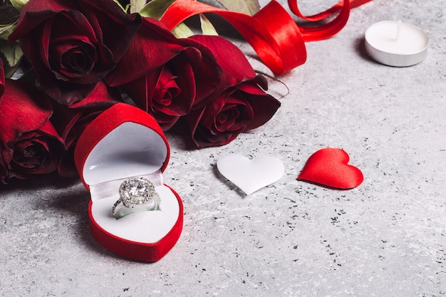 Valentines day marry me wedding engagement ring box with red rose Free Photo