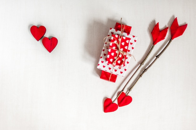 Valentines Day Twig Arrows On White Wooden Background With Gift