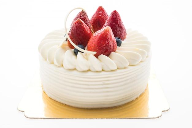 Vanilla cream cake with strawberry on top Free Photo