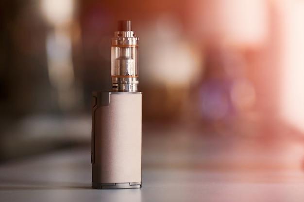 Vape, electronic cigarette. blurred background. Premium Photo