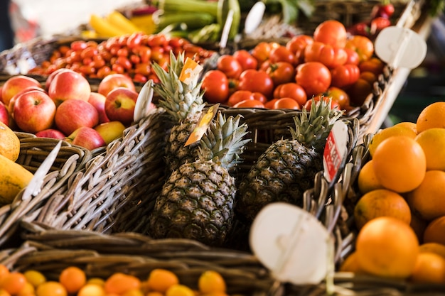 Variation of fruits in wicker basket at market place Free Photo