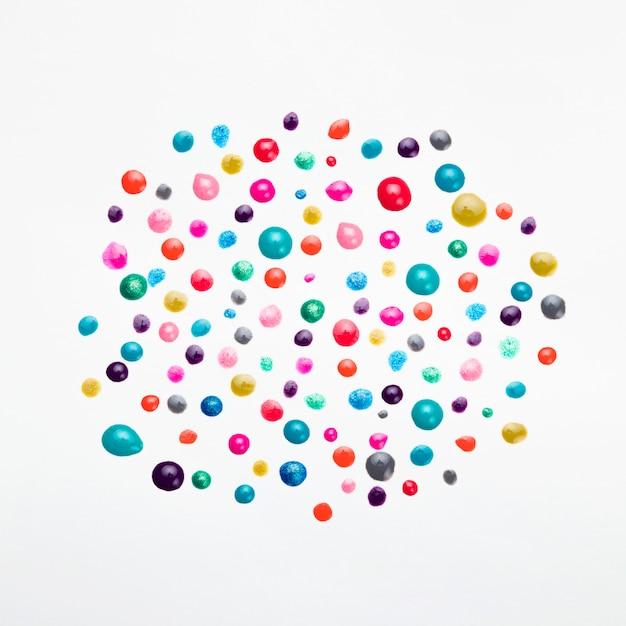 Variation of nail polish drop on white background Free Photo