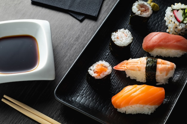 Varied sushi plate on wood table Premium Photo