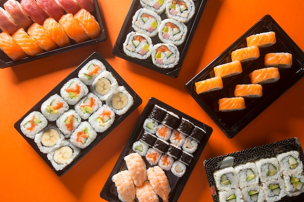 Varied sushi table, seen from above. Premium Photo