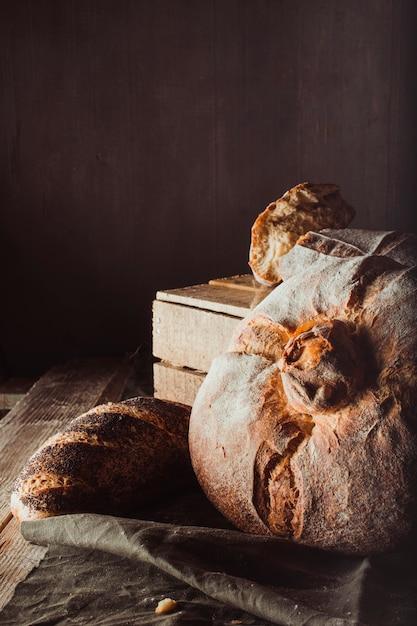 Variety of breads on vintage scene Free Photo