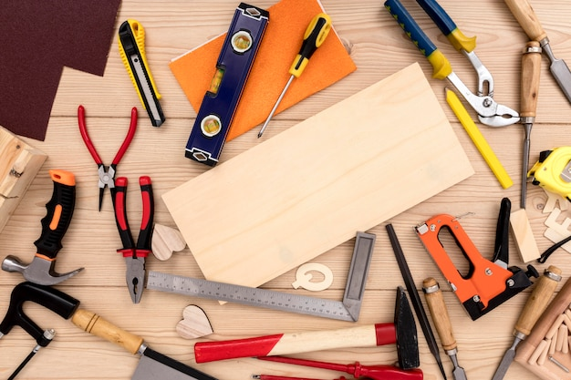 Variety of carpentry tools with copy space wood plank Premium Photo
