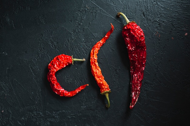 Variety of dried red hot chilli peppers top view Free Photo
