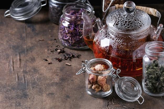 Variety of dry tea with teapot Premium Photo