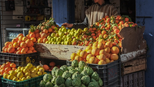 Variety of fresh fruits and vegetables for sale in the local market. Premium Photo
