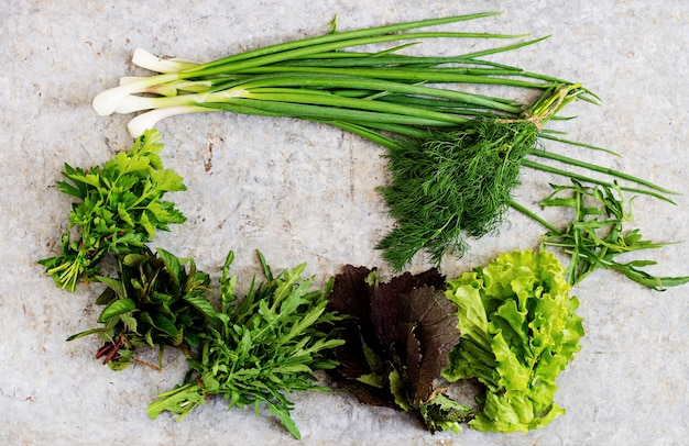 Variety fresh organic herbs (lettuce, arugula, dill, mint, red lettuce and onion). top view Free Photo