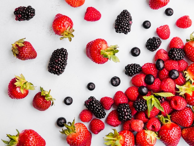 Variety of fresh sweet berries on white background Free Photo