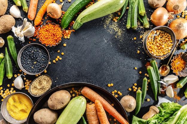 Variety of fresh tasty vegetables on dark background Free Photo