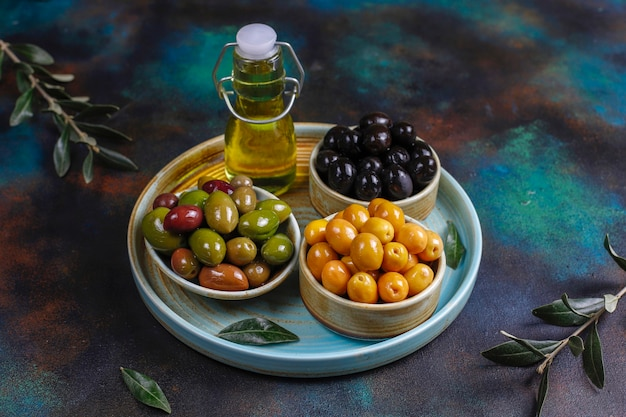 Variety of green and black whole olives. Free Photo