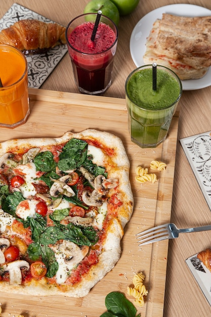 Variety of healthy food, smoothies and pastries. Premium Photo