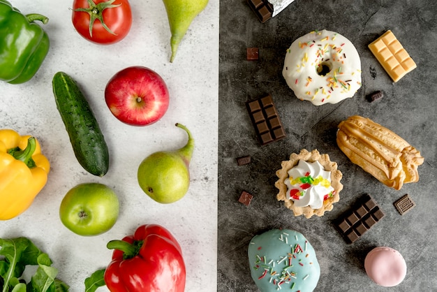 Variety of healthy and unhealthy food over dual background Free Photo