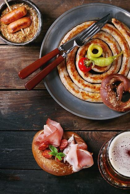 Variety of meat snacks in pretzels Premium Photo
