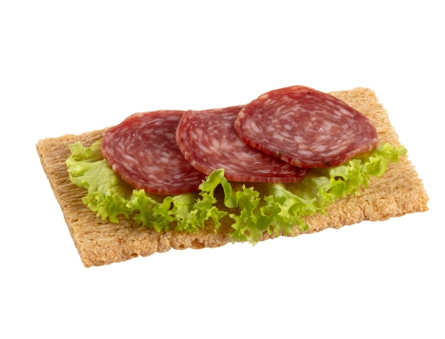Variety of mini sandwiches with cream cheese, vegetables and salami Premium Photo