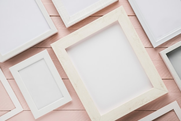 Variety of minimalist frames on wooden background Free Photo