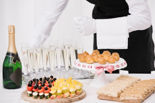 Variety of snacks served with drinks Free Photo
