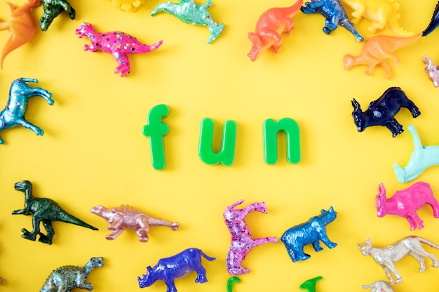 Various animal toy figures background with the word fun Free Photo