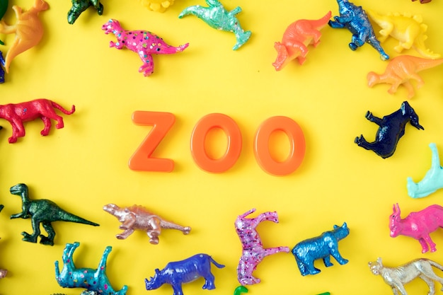 Various animal toy figures background with the word zoo Free Photo