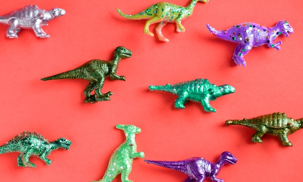 Various animal toy figures in a colorful background Free Photo