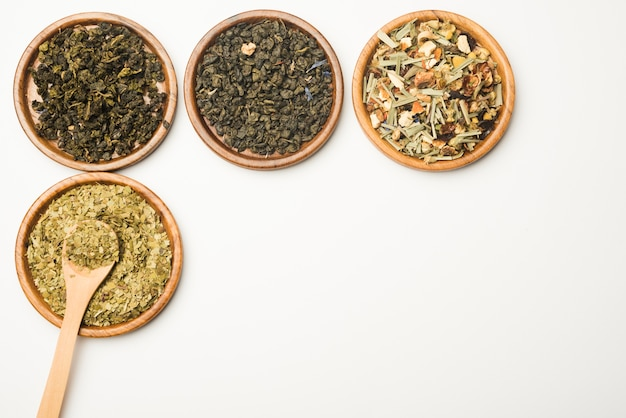 Various assorted natural medical dried herbs on wooden tray Free Photo