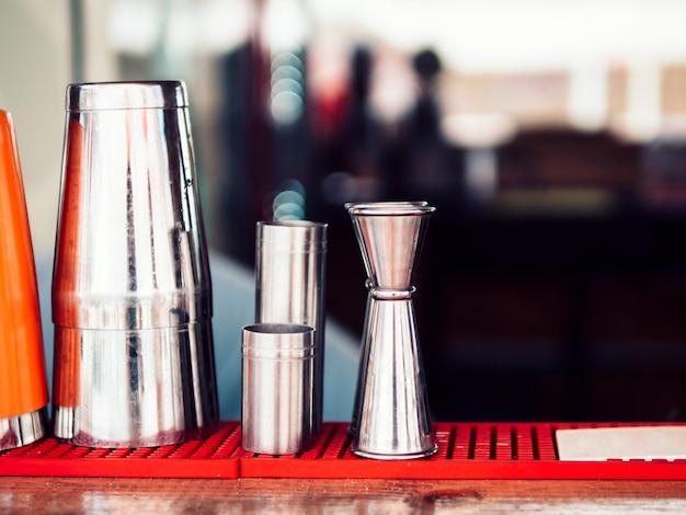 Various bar utensils on counter Free Photo