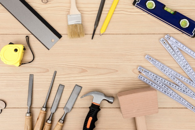 Various carpentry tool top view copy space Free Photo