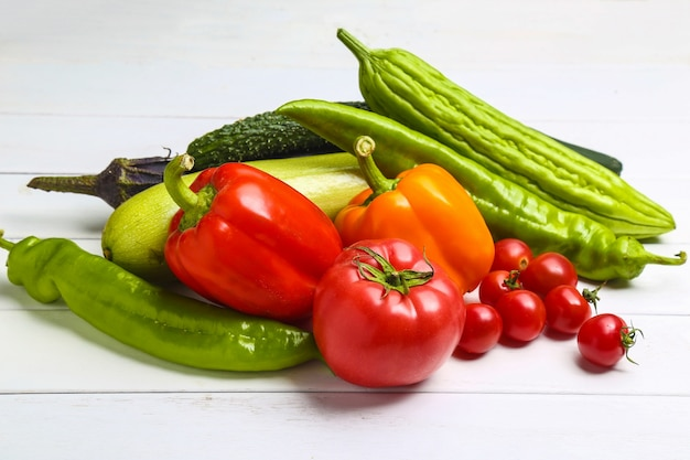 Various colorful vegetables on white wooden table Free Photo