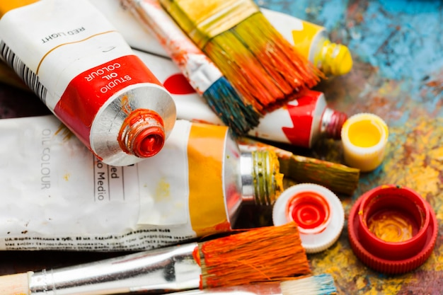 Various colours and sizes of paint Premium Photo