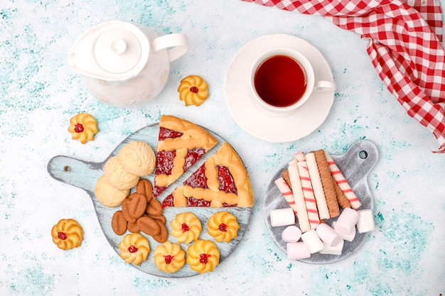 Various cookies,biscuits and sweets on light surface Free Photo