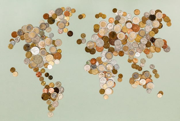 Various currency coins creating the world map Free Photo