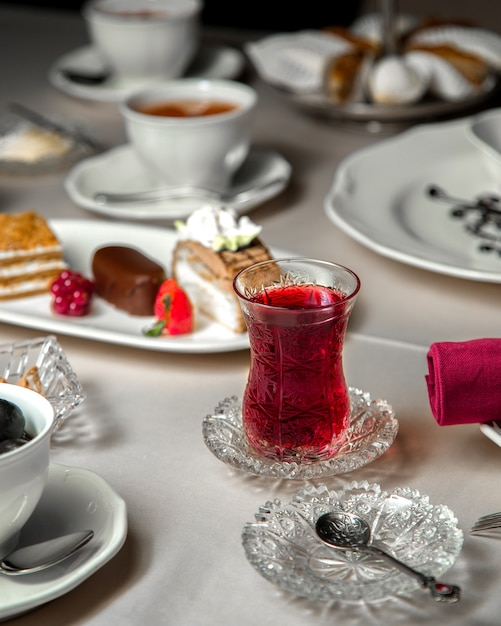 Various dessert selection and a glass of tea Free Photo