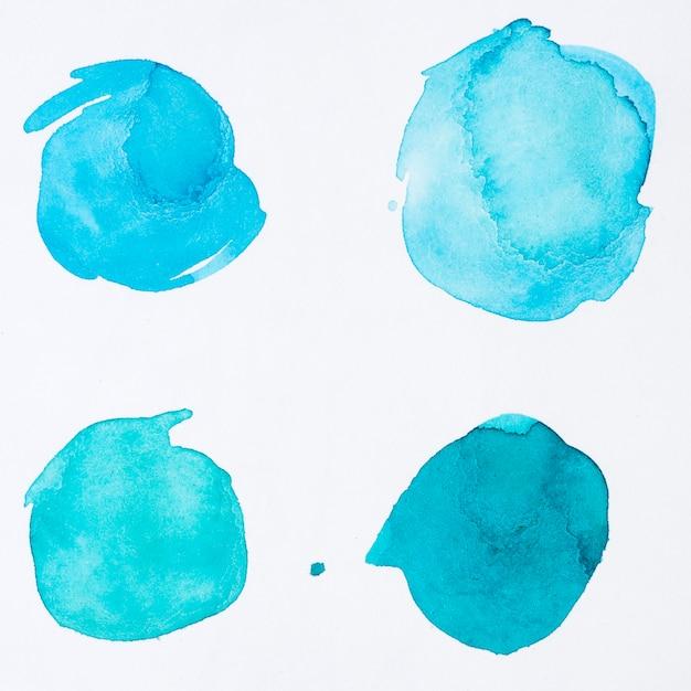 青い水彩絵の具のさまざまなドット Premium写真