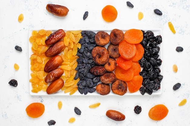 Various dried fruits,dates,plums,raisins and figs Free Photo