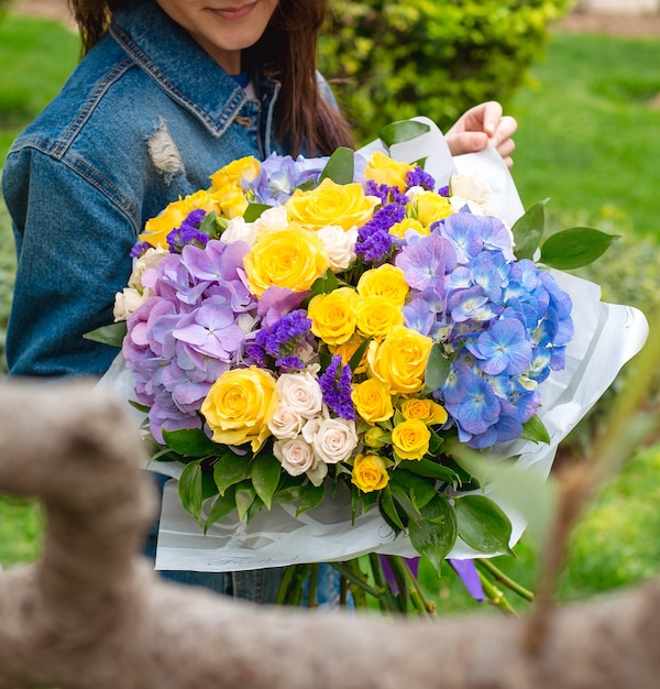 Various flowers in girl hands Free Photo