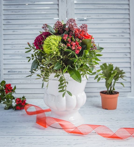 Various flowers on the table Free Photo